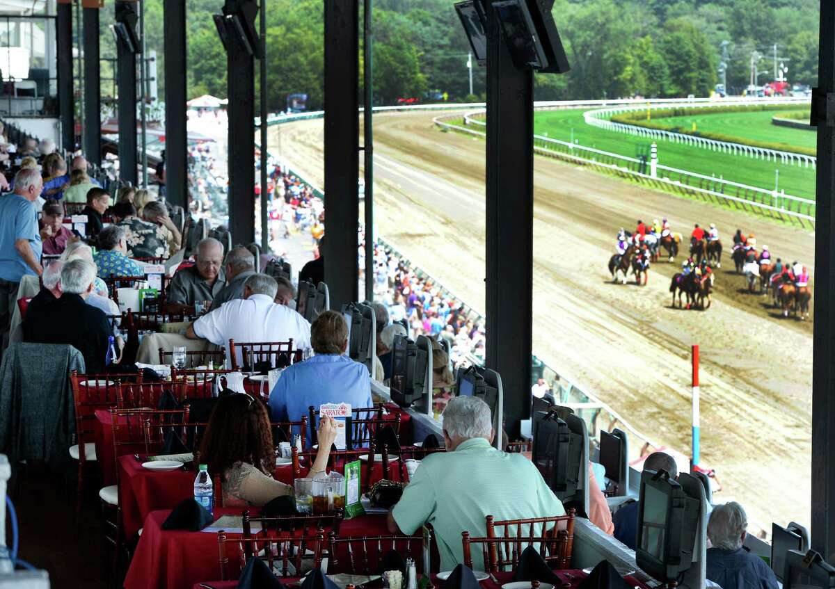 A view from the Turf Terrace as horses parade to post Monday, July, 22, 2013, at Saratoga Race Course in Saratoga Springs, N.Y. Reservations for the Turf Terrace go on sale online Wednesday. (Skip Dickstein/Times Union)