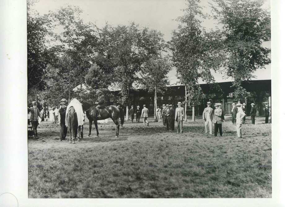 Saddling: The paddock during post parade at Saratoga Race Course in Saratoga Springs, N.Y., date unknown. (Courtesy of Saratoga Springs Historical Museum, George S. Bolster collection)