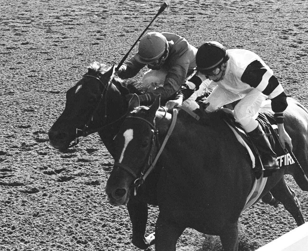 ** FILE ** In this June 10, 1978 file photo, Affirmed, Steve Cauthen up, right, battles Alydar, Jorge Valasquez up, down the stretch of the Belmont Stakes at Belmont Park in Elmont, N.Y., June 10, 1978. Thirty years later, Cauthen is ready to give up the title as