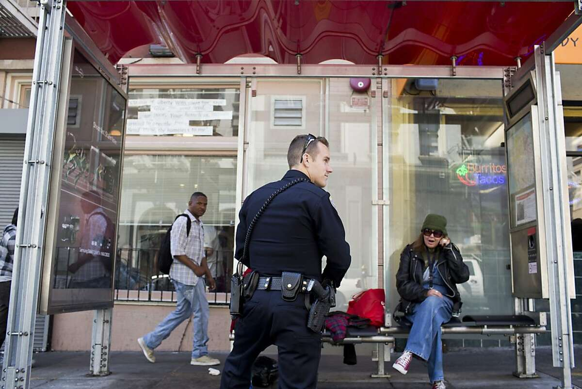 The bus stop with the highest crime rate in the city at the corner of Leavenworth and Eddy Streets in San Francisco, Calif., Wednesday, July 24, 2013. Here SFPD patrolman Joel Aylworth chats with people sitting at the stop.