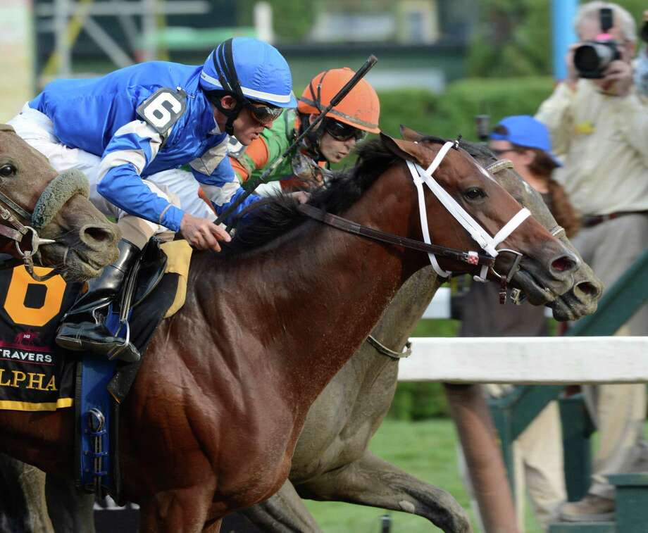 Alpha with jockey Ramon Dominguez, left dead heats with Golden Ticket with jockey David Cohen, right for the win in the 143rd running of The Travers Stakes  at the Saratoga Race Course  in Saratoga Springs, N.Y. Aug. 25, 2012.   (Skip Dickstein/Times Union) Photo: Skip Dickstein