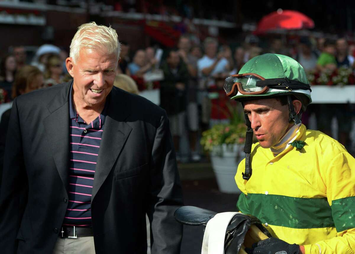 Former Giants head coach Bill Parcells is all smiles, left as he talks with winning his jockey Ramon Dominguez after his horse Saratoga Snacks won the 8th race at the Saratoga Race Course in Saratoga Springs, N.Y. Aug 10, 2012. (Skip Dickstein/Times Union)