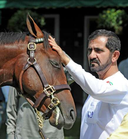 HH The Emir Sheikh Mohammed bin Rashid Al Maktoum shares a quiet moment with a sales yearling August 1, 2020,  at the Fasig-Tipton sales in Saratoga Springs, N.Y.  (Skip Dickstein/Times Union) Photo: Skip Dickstein