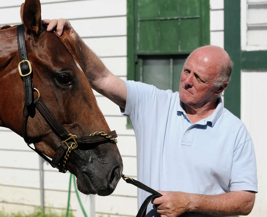 Trainer Leroy Jolley works with one of his charges at the Stakes Barn Sept. 2, 2009, at Saratoga Race Course in Saratoga Springs, N.Y. (Skip Dickstein / Times Union)