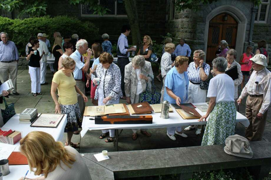 Parisioners at First Congregational Church of Greenwich look at historic artifacts as part of the church's celebration of Greenwich Founders Day. Photo: Contributed Photo