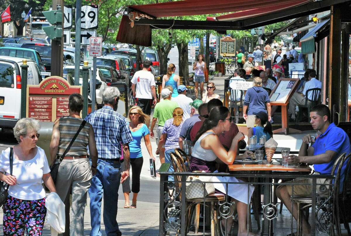 Saratoga Springs' sidewalks and cafes fill up along Broadway as the summer season begins Wednesday, July 6, 2011. (John Carl D'Annibale / Times Union)