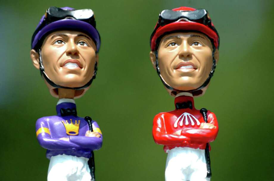 Angel Cordero bobble head dolls, the limited edition is in the purple silks, Thursday July 26, 2007, at the Saratoga Race Course in Saratoga Springs, N.Y. (Cindy Schultz/Times Union) Photo: CINDY SCHULTZ / ALBANY TIMES UNION