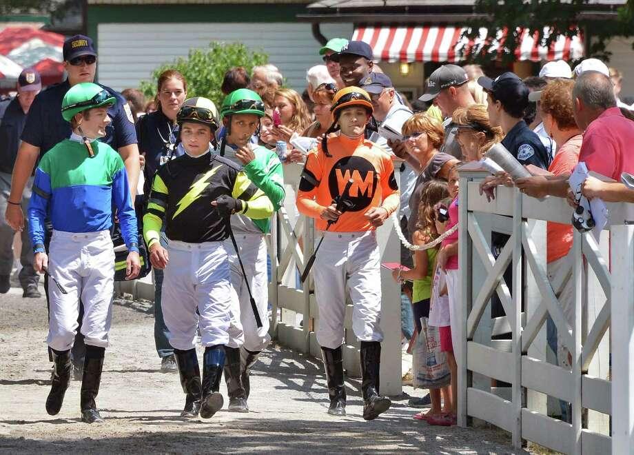 Jockeys arrive at the paddock at Saratoga Race Course Friday July 20, 2012.   (John Carl D'Annibale / Times Union) Photo: John Carl D'Annibale / 00018477B