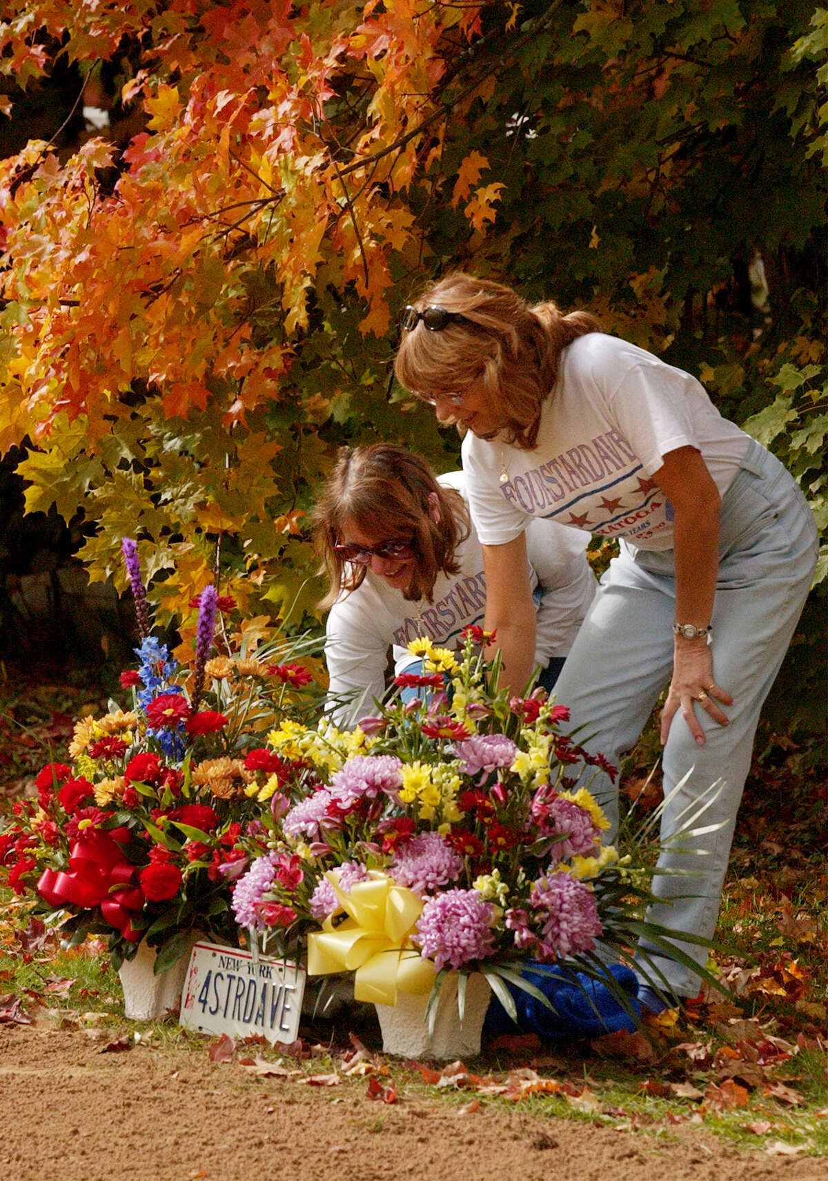 105. Four horses are buried on the Saratoga grounds. Go for Wand is in the infield, and Fourstardave, Mourjane and A Phenomenon are at Clare Court on the backstretch. Kathleen Manaco and Carol Conti fix the wreathes at the buriel site of Fourstardave in the Clare Court area of Saratoga Race Course in Saratoga Springs N.Y, Oct. 17, 2002. Fourstardave died on Monday after a jog at Belmont Park in Elmont New York. (Skip Dickstein/Times Union)