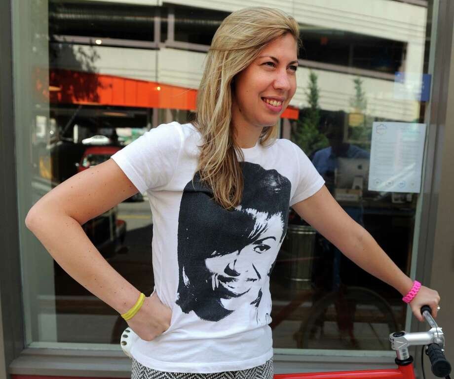 Marcella Kovac, 32, of Bridgeport, wears a Michelle Obama tee, screenprinted by local artist Liz Squillace of Paradox Ink, Tuesday, July 23, 2013 in Bridgeport, Conn. Photo: Autumn Driscoll / Connecticut Post