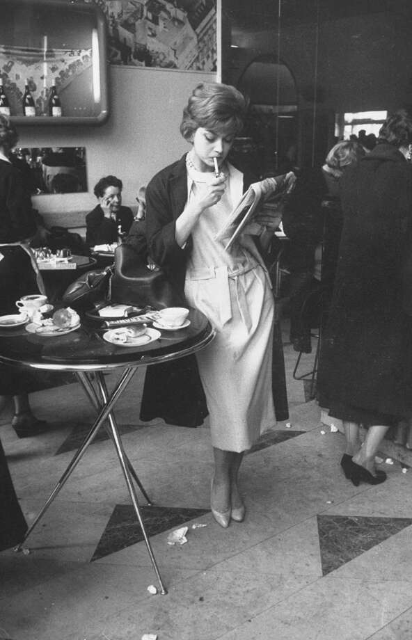 French fashion model Marie-Helene Arnaud (C) reading in a cafe. Photo: Loomis Dean, Time & Life Pictures/Getty Image