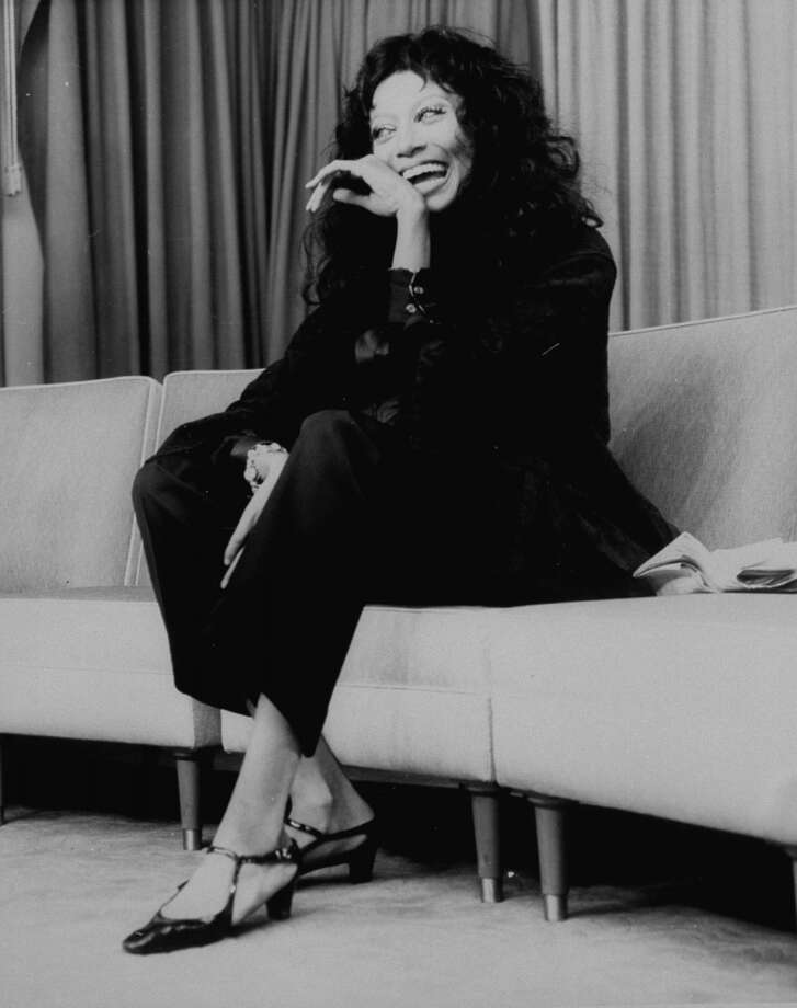 Fashion model Donyale Luna sitting on couch, probably during interview. Photo: Time Life Pictures, Time & Life Pictures/Getty Image