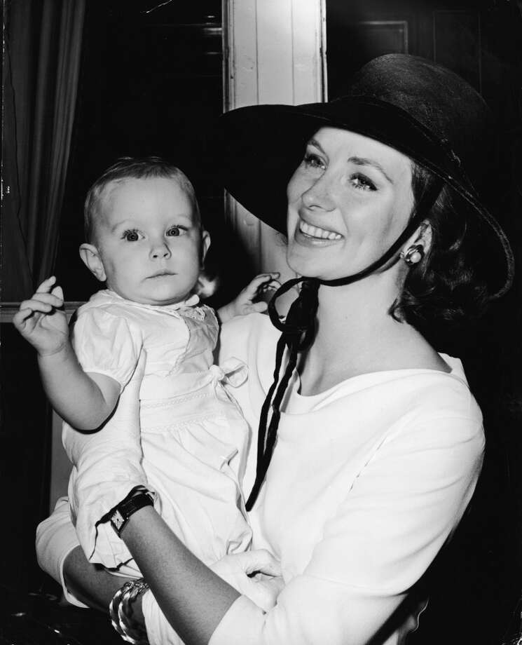 American model and actress Suzy Parker holds her daughter Georgia de la Salle in her arms as they arrive on the liner 'Liberte' for the premiere of Parker's new film 'Circle of Deception,' in 1960. Photo: Phil Burchman, Getty Images