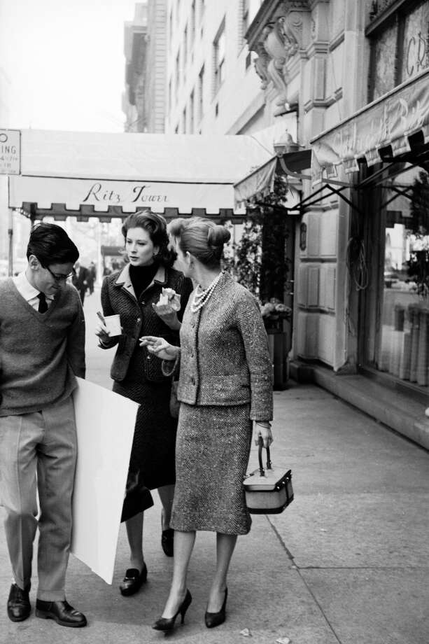 From left, American photographer Richard Avedon, model and actress Suzy Parker and advertising executive Kathleen Daly talk as they walk along Park Avenue past the Ritz Tower, New York in 1959. Photo: Martha Holmes, Time & Life Pictures/Getty Image