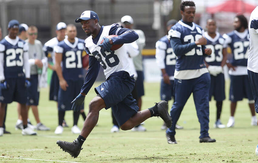 Receiver Dez Bryant runs into the open during the morning session of the 2013 Dallas Cowboys training camp on Wednesday, July 24, 2013 in Oxnard.