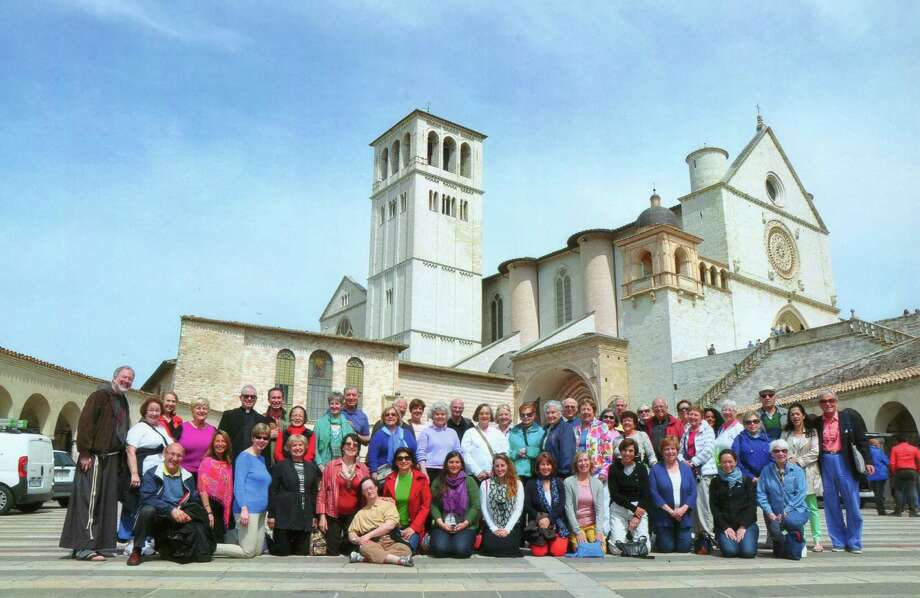 St. Catherine of Siena parishioners, relatives and friends gather before the Basilica of St. Francis in Assisi during a stop on their 11-day tour of Italy, which the group took as part of a year-long celebration of St. Catherineís 100th anniversary. Photo: Contributed Photo