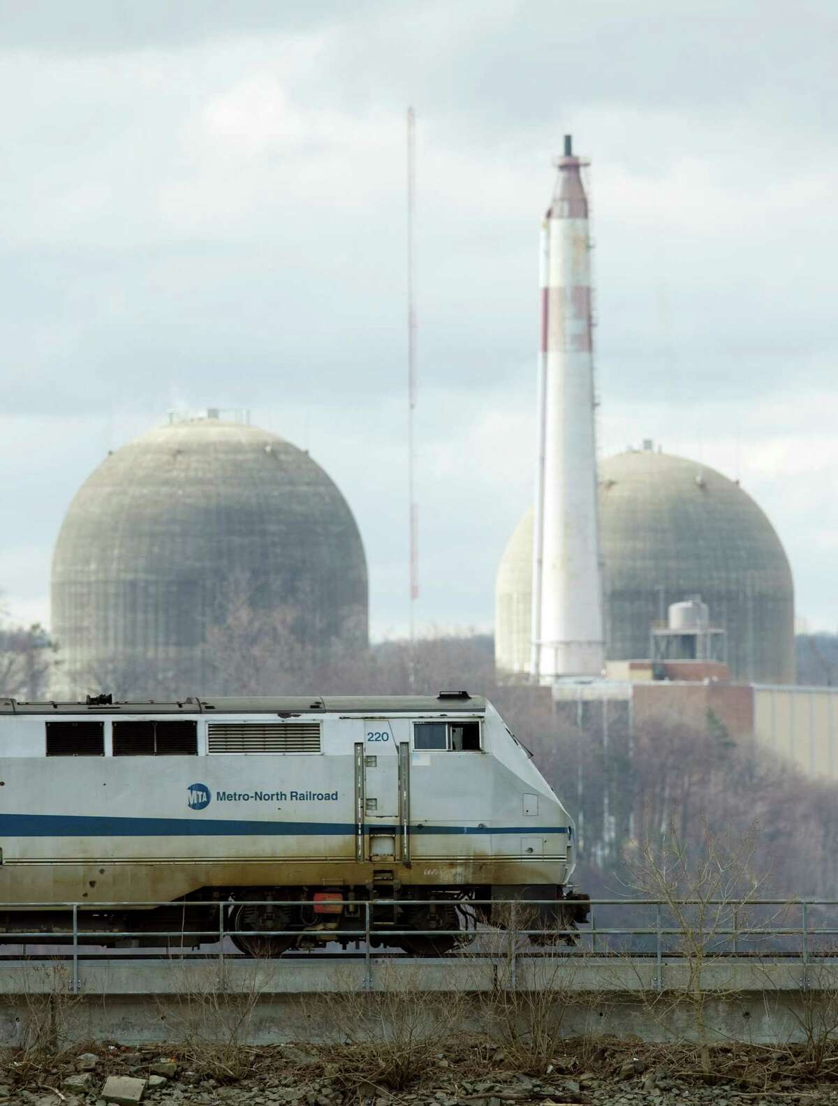 A train passes by in front of Indian Point Nuclear Power Plant on the Hudson River March 22, 2011 in Buchanan, NY. The Indian Point station, comprised of two operating nuclear reactors, sits atop the Ramapo fault line, causing concern for some residents in the wake of the Japan disaster. AFP PHOTO / DON EMMERT (Photo credit should read DON EMMERT/AFP/Getty Images)