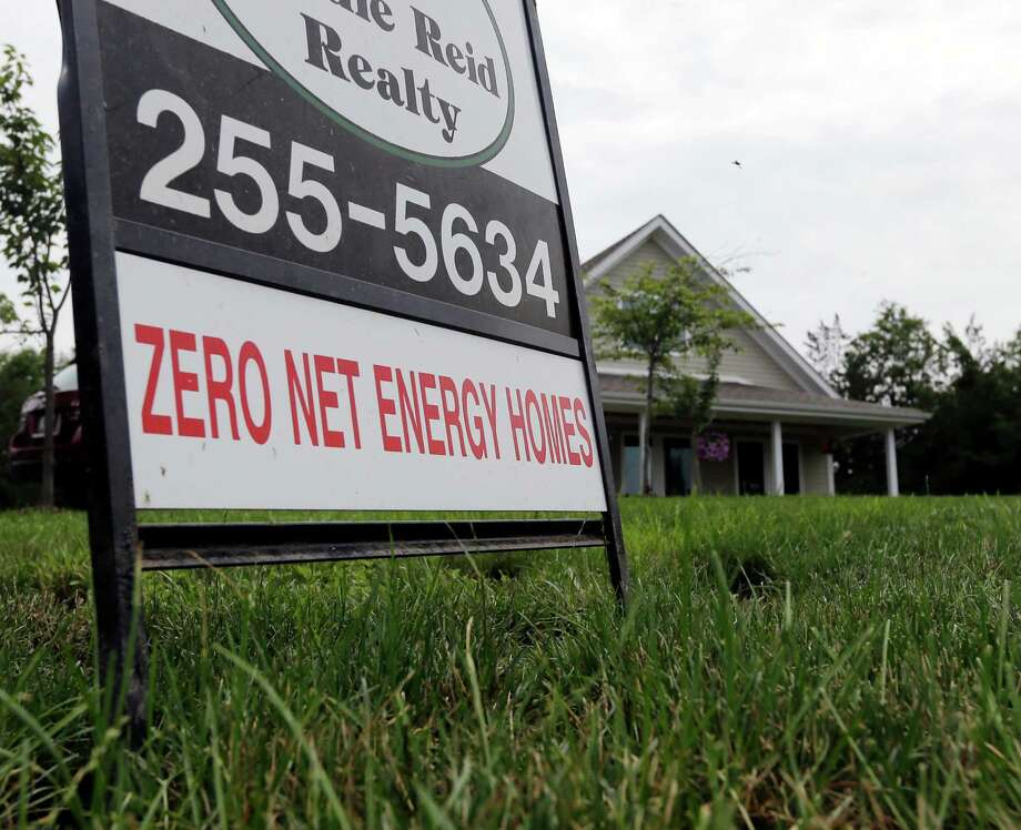In this Tuesday, July 9, 2013, photo,  a zero net energy home is listed for sale in New Paltz, N.Y. Home sales for June are reported Wednesday, July 24, 2013. AP Photo/Mike Groll) ORG XMIT: NYBZ128 Photo: Mike Groll / AP