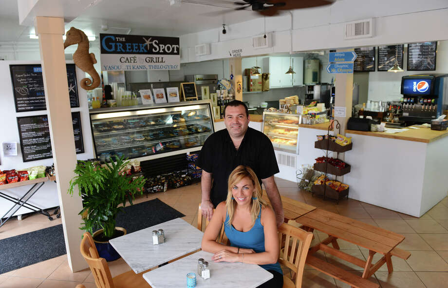 Stephanie Hlias and her husband Leo Koutikas, both own the newly opened The Greek Spot restaurant on East Broadway in Milford, Conn. on Wednesday July 24, 2013. Photo: Christian Abraham / Connecticut Post