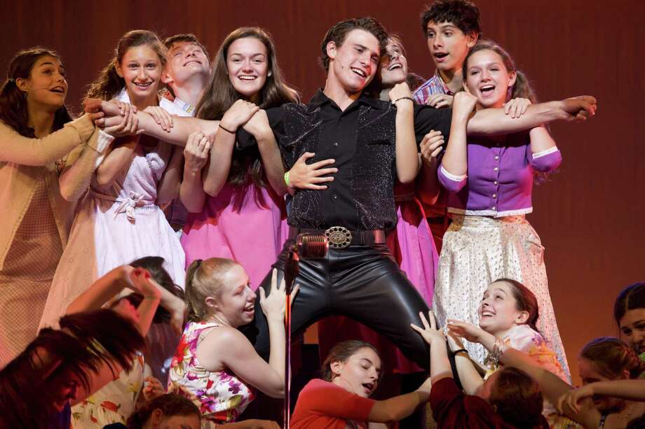 "Early rockin 'roll star Conrad Birdie (Jack Siegenthaller) is surrounded by adoring teenage fans in a scene from Staples Summer Theatre's production of the musical ""Bye Bye Birdie,"" playing July 26-28 at Staples High School. Photo: Contributed Photo / Westport News"