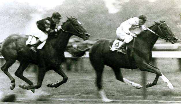 Man o' War, left, with Willie Knapp is beaten by Upset ridden by Johnny Loftus Aug. 13, 1919, in the Sanford Stakes at Saratoga Race Course. (C.C. Cook/Times Union archive)