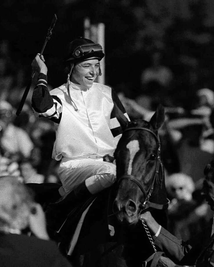 Jockey Steve Cauthen celebrates aboard Affirmed after winning the Belmont Stakes and Triple Crown in 1978 — the last to do so.Click through the photos for a look at the 14 other horses were were in striking distance of horse racings greatest feat but failed. / AP