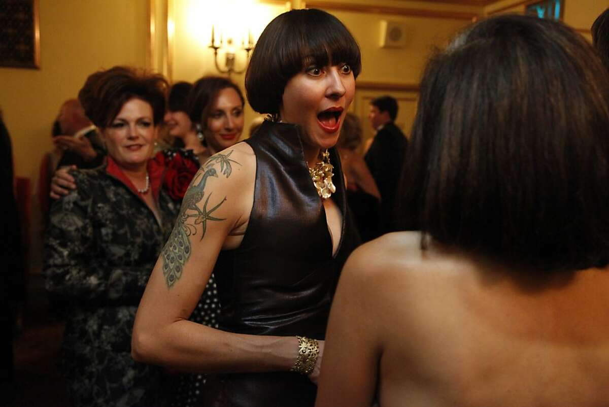 Amber Marie Bently talks with friends during the San Francisco Opera's opening in September 2012. Her body was found in an apartment building in Gardnerville, Nev., on July 19, 2013.