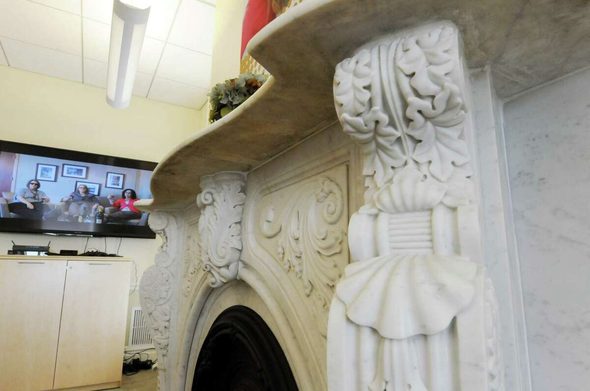 An ornate fireplace is the centerpiece of a community room at the new Berkshire Bank branch in the historic Stanford mansion Wednesday morning, July 24, 2013, in Niskayuna, N.Y. The bank branch is located in Mansion Square at the intersections of Balltown Road and State Street. (Will Waldron/Times Union)