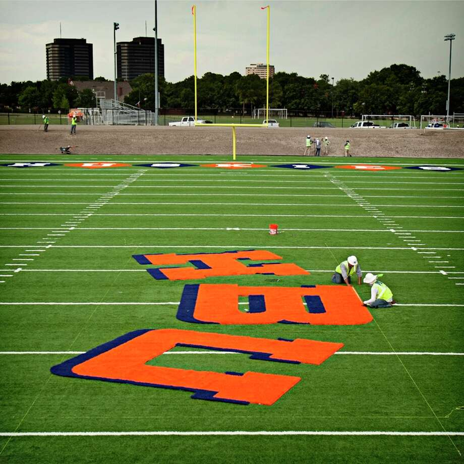 Preparations are ongoing for Houston Baptist's first football season, including the painting of the school's new on campus turf field (Dunham Field), which now serves as a practice field and will be the team's home field for games in 2014. (Michael Tims/HBU) Photo: Michael Tims/HBU