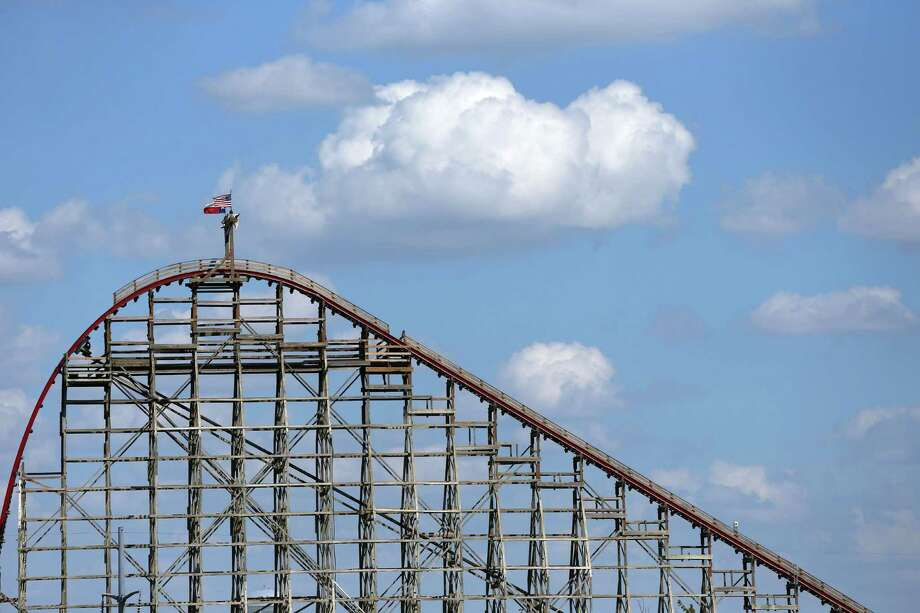 Emergency personnel have rescued eight people from a new roller coaster at Six Flags Over Texas in Arlington after it stopped on an upper area of track. Photo: Ronald Martinez, Getty Images / 2013 Getty Images