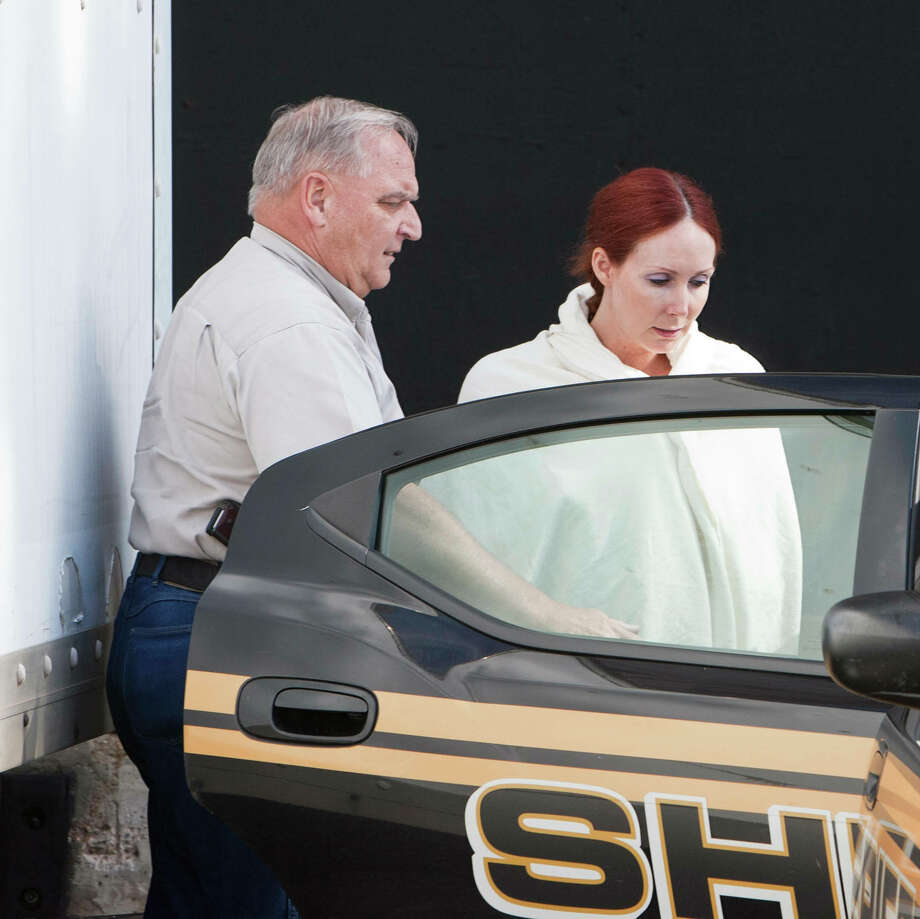 Shannon Richardson is placed into a Titus County Sheriff's car in early June after an initial appearance at the federal building in Texarkana. Photo: Curt Youngblood, MBR / Texarkana Gazette