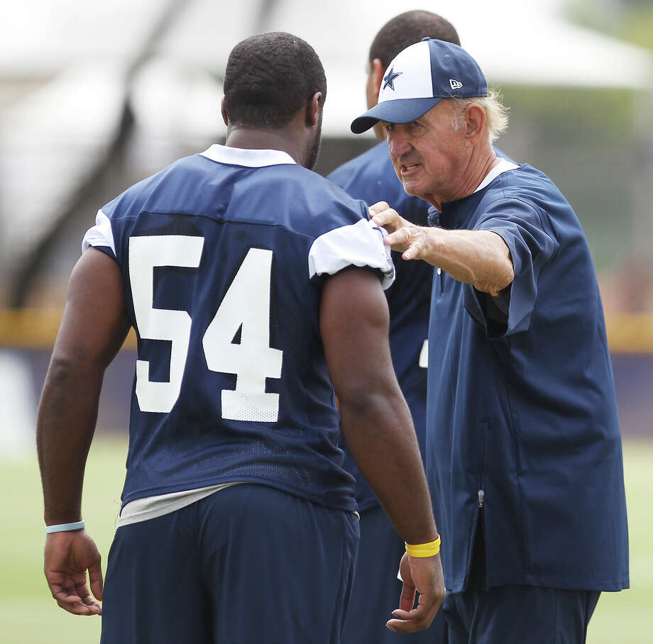 Defensive coordinator Monte Kiffin talks to linebacker Bruce Carter (54) during the morning session of the 2013 Dallas Cowboys training camp on Wednesday, July 24, 2013 in Oxnard. Photo: Kin Man Hui, San Antonio Express-News / ©2013 San Antonio Express-News