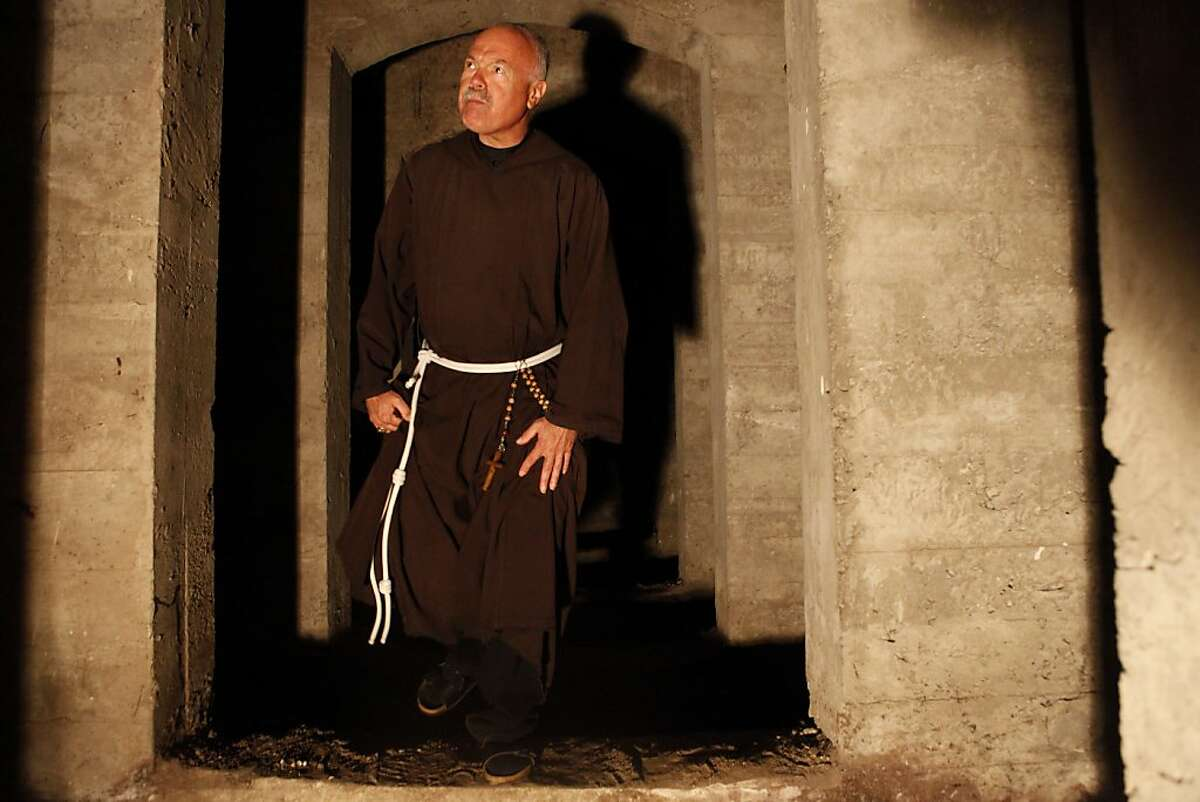 Father Harold Snider, O.F.M. Capuchin, Rector of The National Shrine of St. Francis of Assisi, walks throughout the area that will be the future space of a columbarium underneath the church to house the ashes of beloved dogs, cats and other family pets in San Francisco, Calif. on July 24, 2013.