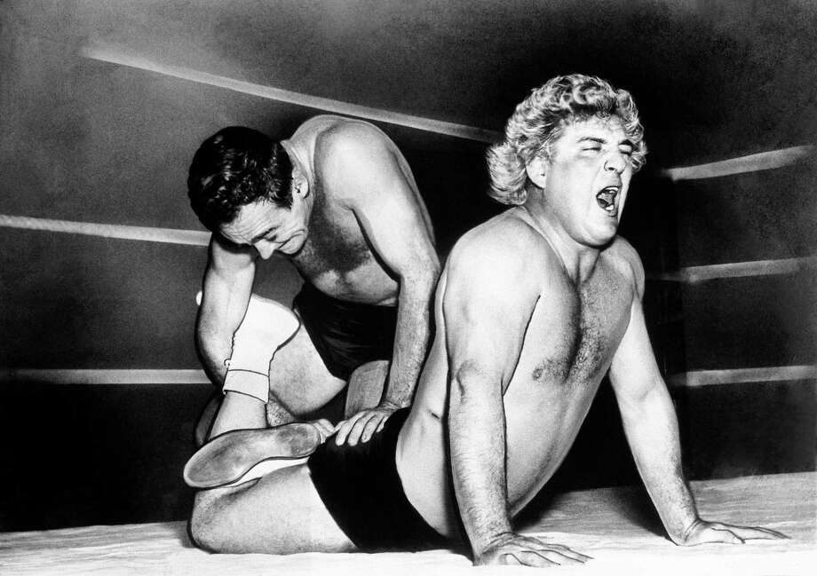 Maybe the prince will have the luscious locks of Hollywood wrestler Gorgeous George Wagner. Photo: Bill Ingraham, Associated Press