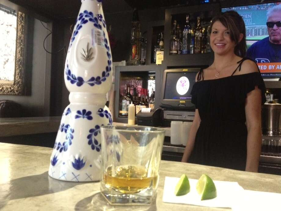 Megan Murphy, a bartender at The Worm, and a shot of Clase Azul Reposado, her preferred sipping tequila.