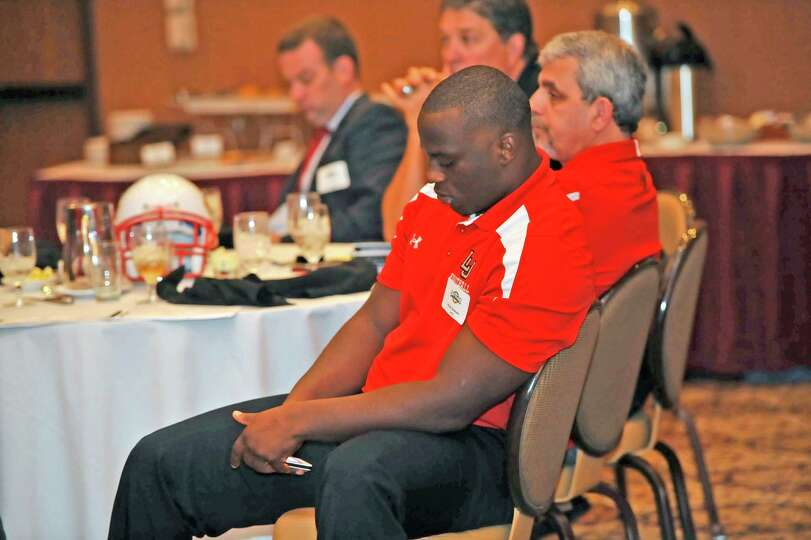 Lamar football player Jesse Dickson checks his phone while the rule changes were being announced.  T