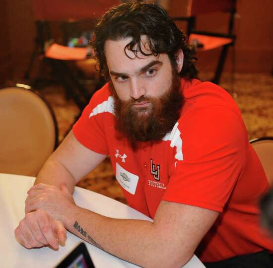 Lamar player Mark Murrill listens to a question being presented to him at their table.  The Southlan
