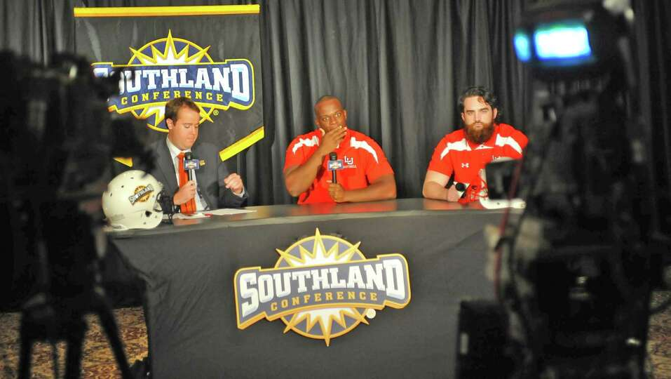 Lamar player Jesse Dickson, middle, and teammate Mark Murrill, right, answer a question from ESPN3 h