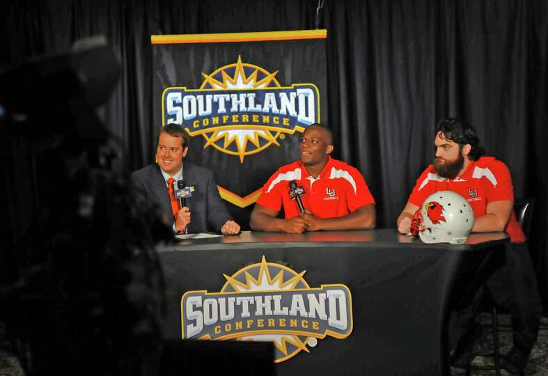 Lamar player Jesse Dickson, middle, and teammate Mark Murrill, right, listen to directions from ESPN