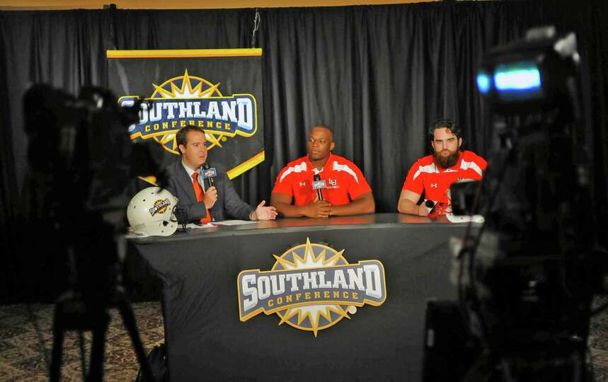 Lamar player Jesse Dickson, middle, and teammate Mark Murrill, right, listen to a questions from ESP