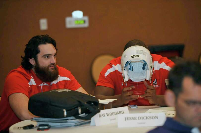 After all the interviews were don for the day, Lamar player Jesse Dickson, right, rests his head on