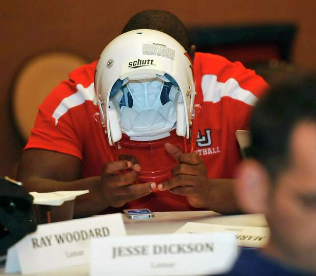 After all the interviews were don for the day, Lamar player Jesse Dickson rests his head on a helmet