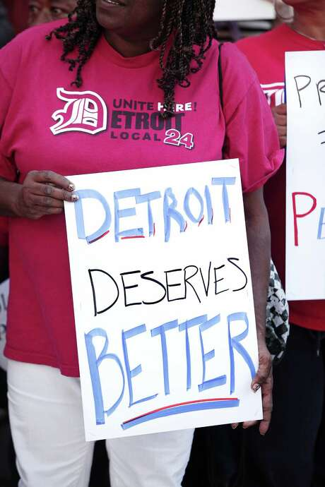 A woman protests Wednesday outside the U.S. Courthouse in Detroit during the city's bankruptcy hearing. Detroit  owes approximately 100,000 creditors. Photo: Getty Images