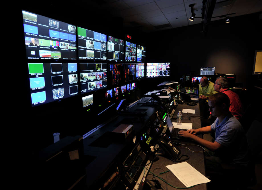 People work in a production control room during the grand opening of the NBC Sports Group facility in Stamford on Wednesday, July 24, 2013. Photo: Jason Rearick / Stamford Advocate