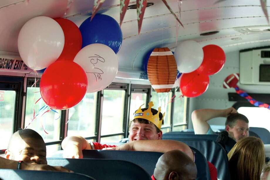 Houston Texans guard Ben Jones wears a paper crown as he rides on a bus with a group of his teammates during the second Verizon Back to Football Care-A-Van Wednesday, July 24, 2013, in Houston. Photo: Brett Coomer, Houston Chronicle / © 2013 Houston Chronicle