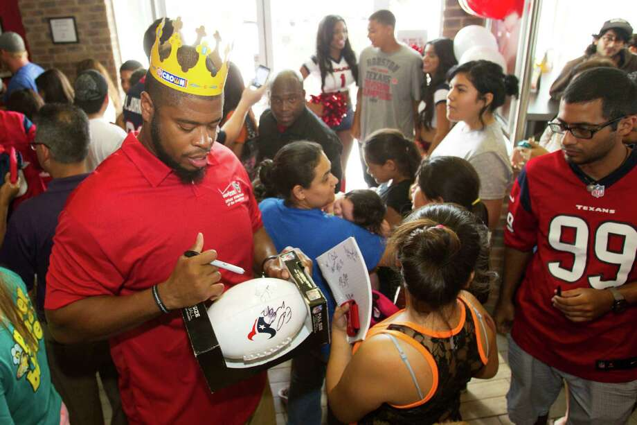 Houston Texans offensive lineman Wade Smith signs autographs during a stop of the second Verizon Back to Football Care-A-Van Wednesday, July 24, 2013, in Missouri City. Photo: Brett Coomer, Houston Chronicle / © 2013 Houston Chronicle