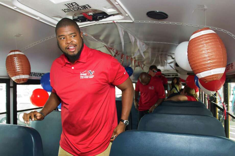 Houston Texans offensive lineman Wade Smith gets off the bus at a stop of the second Verizon Back to Football Care-A-Van Wednesday, July 24, 2013, in Houston. Photo: Brett Coomer, Houston Chronicle / © 2013 Houston Chronicle