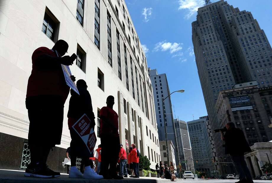 """Firefighters protested outside the Theodore Levin United States Courthouse in Detroit. A lawyer for Detroit argued the city would be """"irreparably harmed"""" if lawsuits challenging a multibillion-dollar bankruptcy are allowed to go forward. Photo: Paul Sancya, STF / AP"""
