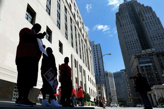 "Firefighters protested outside the Theodore Levin United States Courthouse in Detroit. A lawyer for Detroit argued the city would be ""irreparably harmed"" if lawsuits challenging a multibillion-dollar bankruptcy are allowed to go forward."