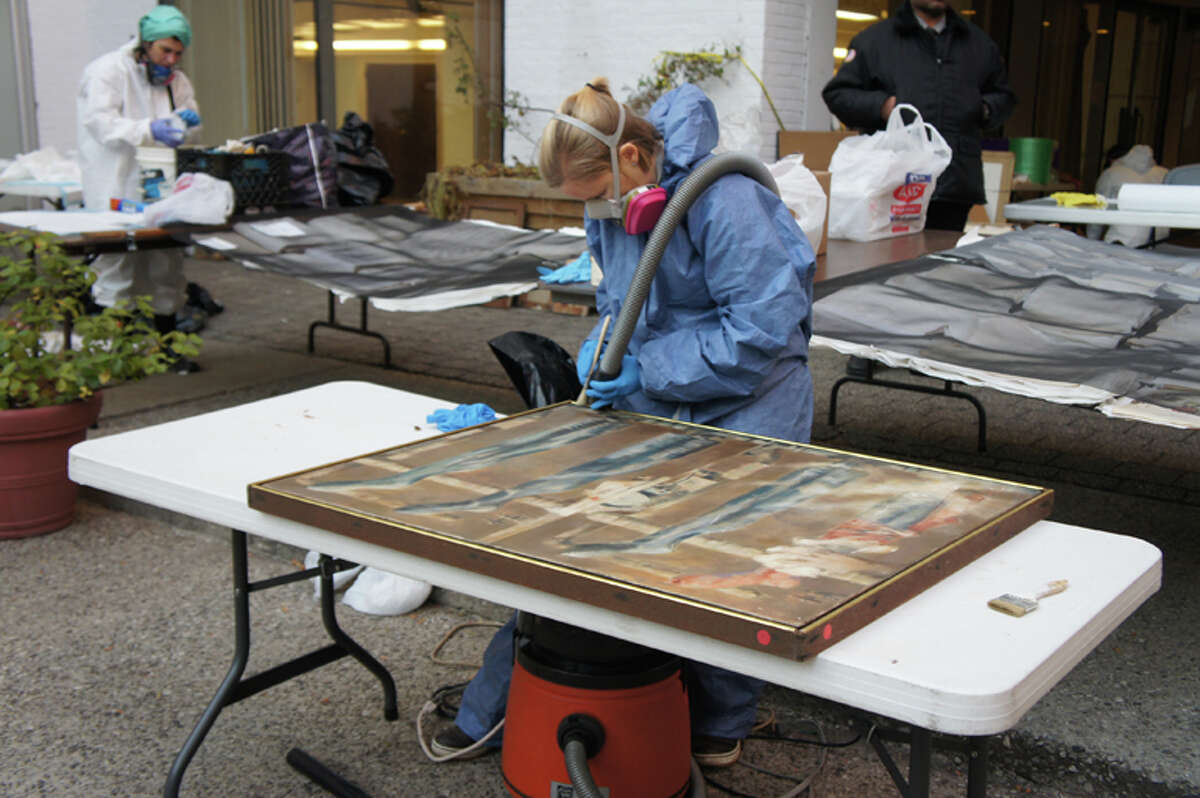 Responders have learned that toilet paper works as well as special tissue in salvaging soaked paintings.